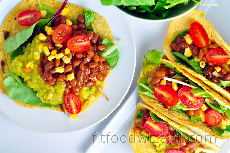 Corn tortillas filled with avocado and beans