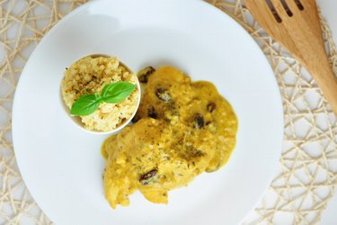 Exotic chicken breasts in mango-coconut sauce with millet