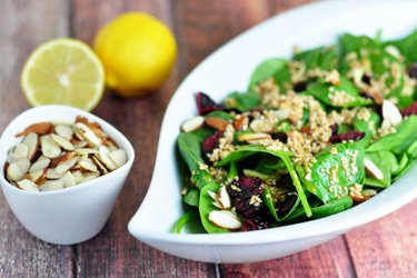 Spinach salad with mustard-honey-sesame seed dressing
