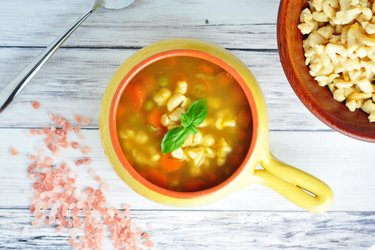 Healthy soup with carrot, peas and chickpea gnocchi