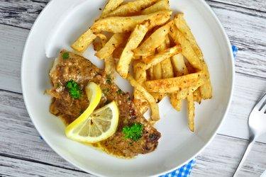 Braised cod in lemon-garlic sauce with celery fries