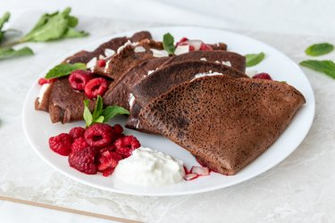 Spelt chocolate crepes with ricotta and hot raspberries