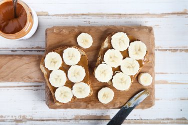 Whole wheat toasts with banana and peanut butter